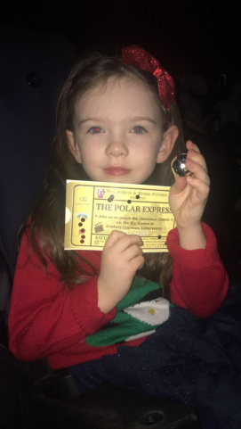 Our Mini-Me ready with her ticket and her bell